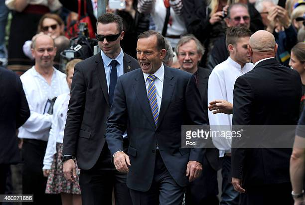 Australian Prime Minister Tony Abbott leaves an ecumenical church service held at Ukrainian Greek Eparchy of Saints Peter and Paul of Melbourne on...