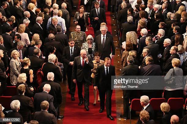 Australian Prime Minister Tony Abbott leaves the state memorial service for former Australian Prime Minister Gough Whitlam at Sydney Town Hall on...