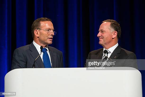 Australian Prime Minister Tony Abbott left and New Zealand Prime Minister John Key make the opening remarks for the TransTasman 2015 Gala Dinner...