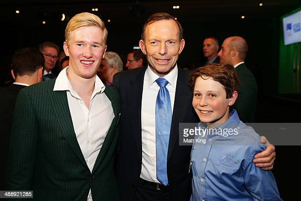 Australian Prime Minister Tony Abbott poses with 2014 Sochi Australian Olympian Jarryd Hughes and 14 year old Paralympian Ben Tudhope during the...