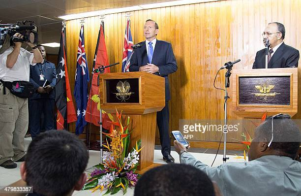 Australian Prime Minister Tony Abbott speaks at a joint press conference with Papua New Guinea's Prime Minister Peter O'Neill in Port Moresby on...