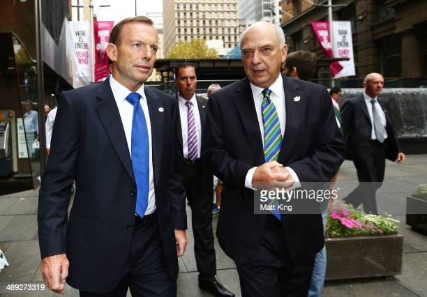 Australian Prime Minister Tony Abbott speaks to Chairman of ICC Cricket World Cup 2015 Ralph Waters during the media opportunity as the one year to...
