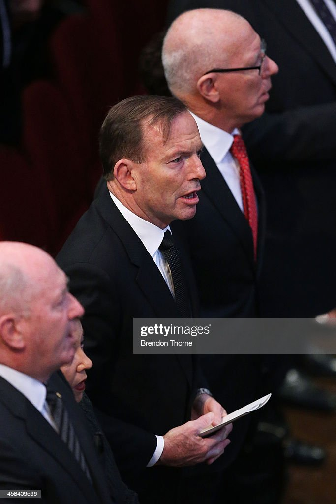 Australian Prime Minister, Tony Abbott stands for the Australian National Anthem at the state memorial service for former Australian Prime Minister Gough Whitlam at Sydney Town Hall on November 5, 2014 in Sydney, Australia. Gough Whitlam was the 21st Prime Minister of Australia. He died on October 21, aged 98.