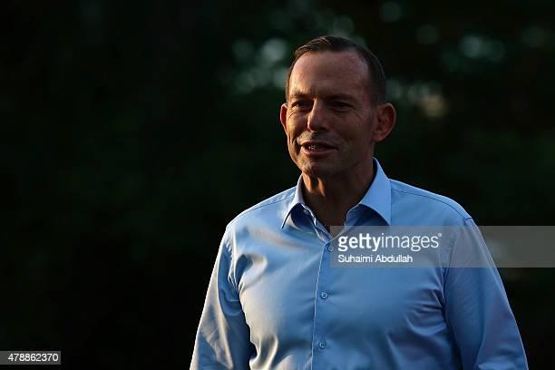 Australian Prime Minister Tony Abbott tours Bishan Park with Singapore Prime Minister Lee Hsien Loong on June 28 2015 in Singapore Australian Prime...