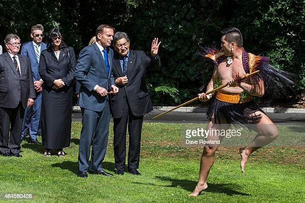 Australian Prime Minister Tony Abbott watches the Powhiri at a welcome ceremony at Government House on February 27, 2015 in Auckland, New Zealand....