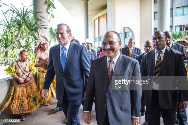 Australian Prime Minister Tony Abbott with his Papua New Guinea's counterpart Peter O'Neill leave after a press conference in Port Moresby on March...