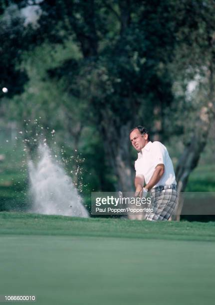 Australian professional golfer David Graham blasts out of a bunker during the Doral Open at the Doral Golf Resort and Spa in Florida, circa March...