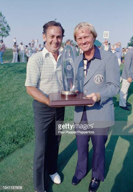 Australian professional golfer David Graham on left is presented with the trophy by American golfer Jack Nicklaus after winning the 1980 Memorial...
