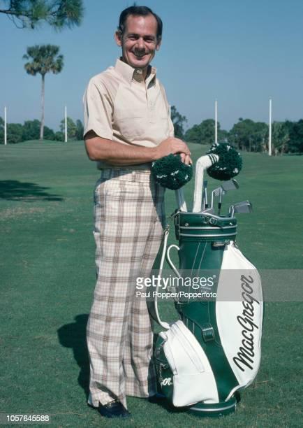 Australian professional golfer David Graham poses with his golf bag, circa November 1980.