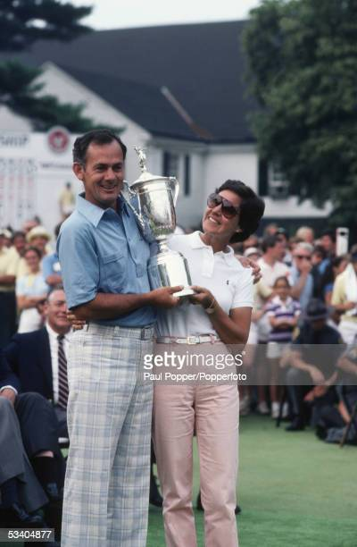 Australian professional golfer David Graham raises the Championship Trophy with his wife Maureen Graham after finishing in first place to win the...