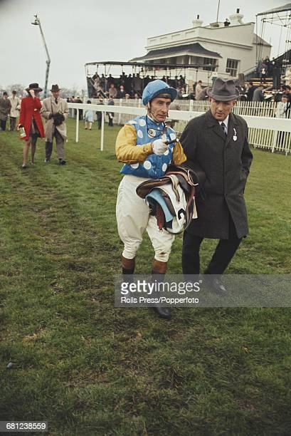 Australian professional jockey Bill Williamson pictured walking with a course official at a race meeting at Newmarket Racecourse in Suffolk, England...
