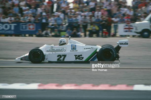 Australian racing driver Alan Jones drives the AlbiladSaudia Racing Team Williams FW07 Ford V8 in the 1979 British Grand Prix at Silverstone circuit...