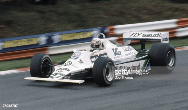 Australian racing driver Alan Jones drives the AlbiladWilliams racing Team Williams FW07B Ford V8 to finish in first place to win the 1980 British...