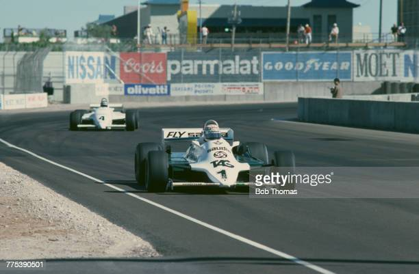 Australian racing driver Alan Jones drives the TAG Williams Racing Team Williams FW07C Ford V8 to finish in first place to win the 1981 Caesars...