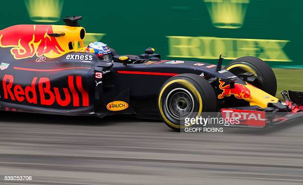 Australian racing driver Daniel Riccardo of Red Bull racing team enters the hairpin turn at the GillesVilleneuve track in Montreal during a morning...