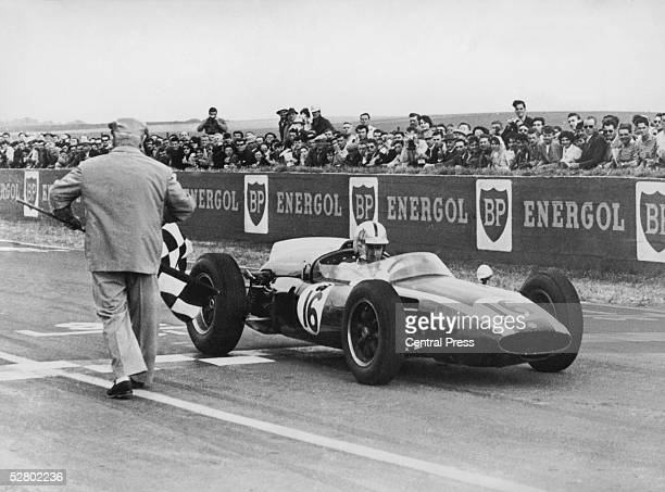 Australian racing driver Jack Brabham takes the chequered flag to win the French Grand Prix at Rheims in a CooperClimax T53 3rd July 1960