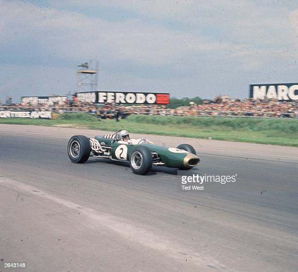 Australian racingdriver Jack Brabham in a Brabham Repco at Silverstone