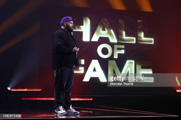 Australian rapper Briggs presents the ARIA Award for Hall of Fame inductee Archie Roach at the 2020 ARIA Awards at The Star on November 25, 2020 in...
