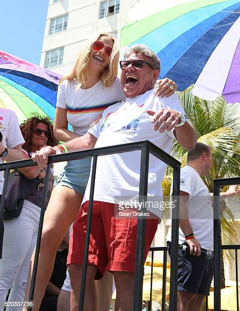 Australian rapper Iggy Azalea and Uncle Johnny of the Elvis Duran Show ride in a float as part of the 8th annual Miami Beach Gay Pride festival on...