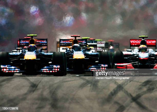 Australian Red Bull Racing Formula One driver Mark Webber leading his Red Bull teammate German Sebastian Vettel and British McLaren driver Lewis...