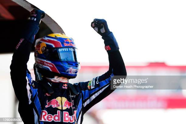 Australian Red Bull Racing Formula One racing driver Mark Webber in Parc Fermé raising his arms and clenching his fists in celebration at winning the...