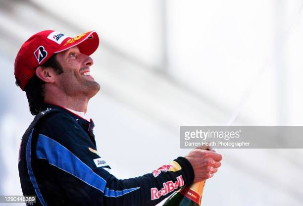 Australian Red Bull Racing Formula One racing driver Mark Webber on the winners podium celebrating winning the 2010 British Grand Prix, Silverstone...