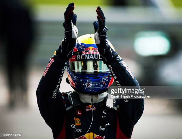 Australian Red Bull Racing Team Formula One team racing driver Mark Webber celebrating winning the race in Parc Fermé by raising his arms and...