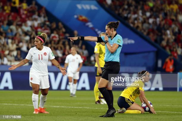 Australian referee Kate Jacewicz blows a whistle during the France 2019 Women's World Cup round of sixteen football match between Sweden and Canada,...