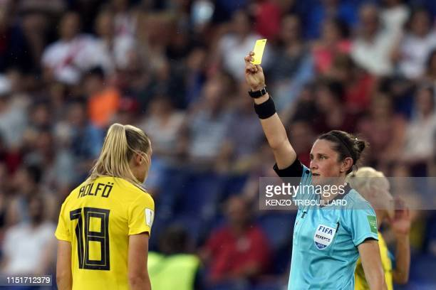 Australian referee Kate Jacewicz shows a yellow card to Sweden's forward Fridolina Rolfo during the France 2019 Women's World Cup round of sixteen...