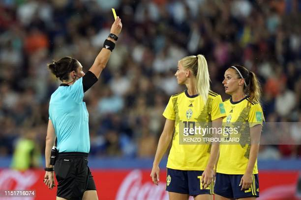 Australian referee Kate Jacewicz shows a yellow card to Sweden's midfielder Kosovare Asllani during the France 2019 Women's World Cup round of...