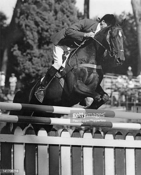 Australian rider Bill Roycroft riding 'Our Solo' in the jumping section of the team three-day eventing in Siena Square during the Rome Olympics, 10th...