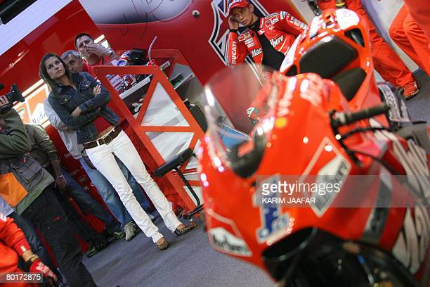 Australian rider Casey Stoner and his wife Adriana attend the 2008 MotoGP qualifying practice in Doha on March 8, 2008. World champion Stoner begins...