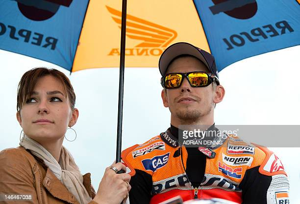 Australian rider Casey Stoner and his wife Adriana Tuchyna waits on the grid ahead of the MotoGP race at the British Grand Prix at Silverstone...