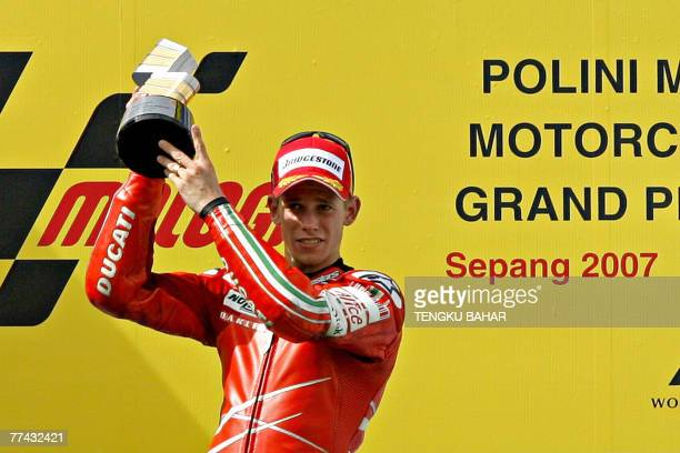 Australian rider Casey Stoner of Ducati celebrates after winning the Malaysian Motorcycle Grand Prix at the Sepang International Racing Circuit in...