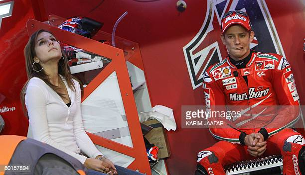 Australian rider Casey Stoner sits next to his wife Adriana as she watches the monitor during the 2008 MotoGP free practice in Doha on March 7 2008...