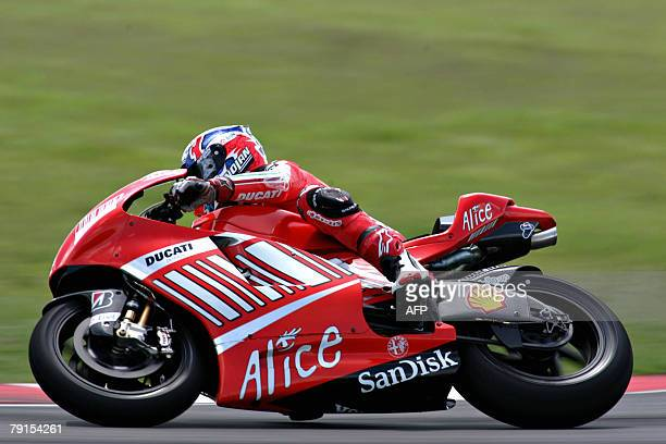 Australian rider Casey Stoner takes a corner on his Ducati during a MotoGP preseason test session at the Sepang International Racing Circuit in...