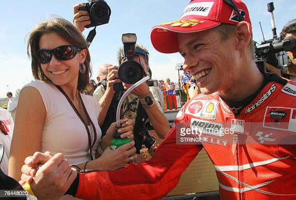 Australian rider Casey Stoner with his wife Adriana celebrates after gaining pole position at MotoGP San Marino Grand Prix in Misano Adriatico 01...