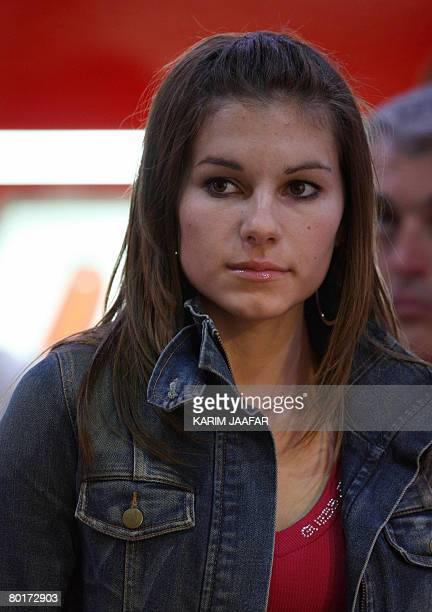 Australian rider Casey Stoner's wife Adriana attends the 2008 MotoGP qualifying practice in Doha on March 8 2008 World champion Stoner begins the...
