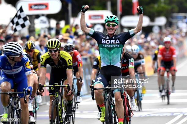Australian rider Jay McCarthy of BoraHansgrohe celebrates as he wins the Cadel Evans Great Ocean Road cycling race in Geelong on January 28 2018 /...
