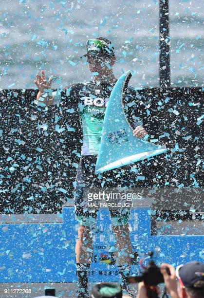 Australian rider Jay McCarthy of BoraHansgrohe celebrates on the podium after winning the Cadel Evans Great Ocean Road cycling race in Geelong on...