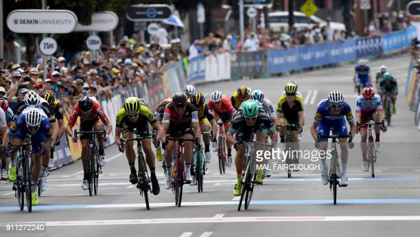 Australian rider Jay McCarthy of BoraHansgrohe sprints to cross the finish line first to win the Cadel Evans Great Ocean Road cycling race in Geelong...
