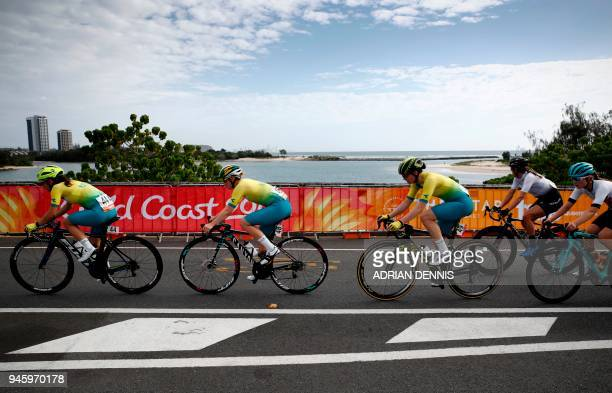 Australian riders lead the peloton as it rides along the coastline during the women's cycling road race event during the 2018 Gold Coast Commonwealth...