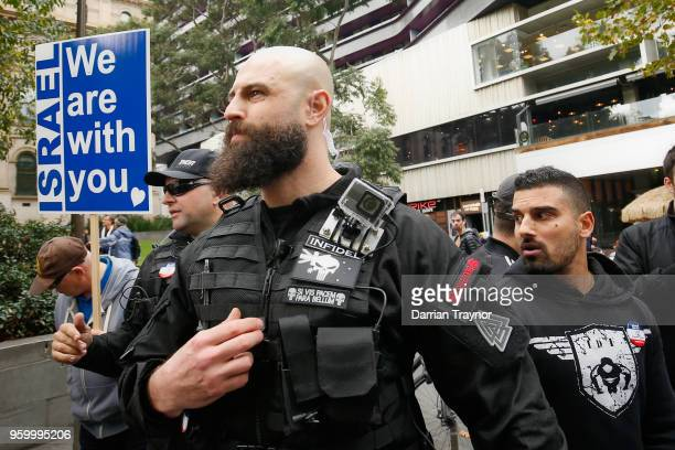 Australian right-wing political activist Avi Yemini and his security men protest against Palestinian activists who formed a march to commemorate the...