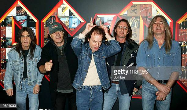 Australian rock band AC/DC attend a photocall at the Carling Hammersmith Apollo October 21 2003 in London