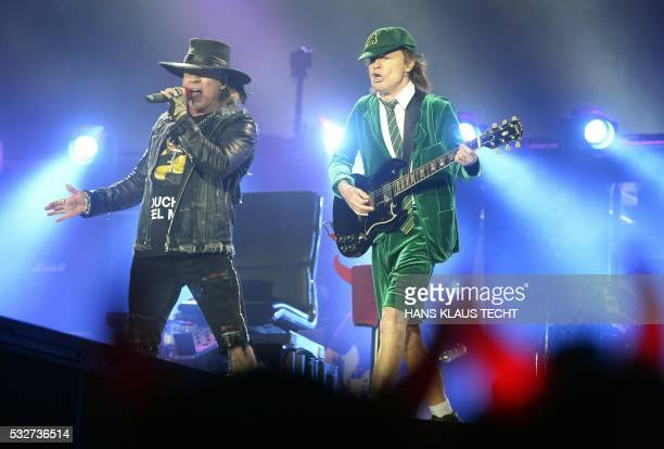 Australian rock band AC/DC's guitarist Angus Young and US singer Axl Rose perform on stage in Vienna Austria on May 19 2016 / Austria OUT