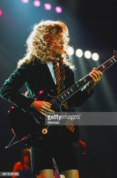 Australian rock group AC/DC performing on stage at Wembley Arena during their 'Fly On The Wall ' World tour pictured is guitarist Angus Young 16th...