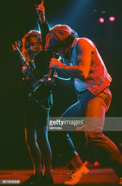 Australian rock group AC/DC performing on stage at Wembley Arena during their 'Fly On The Wall ' World tour pictured is singer Brian Johnson and...