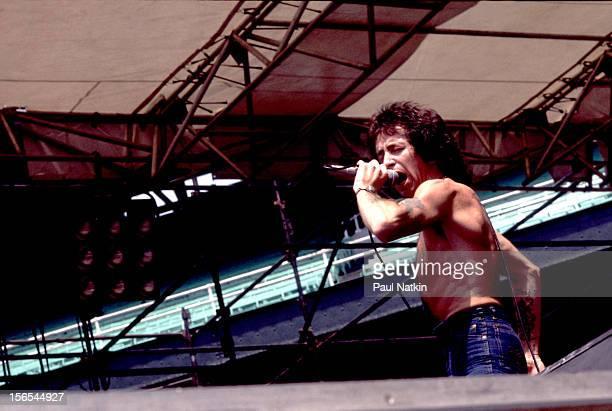 Australian rock group AC/DC performs at Comiskey Park Chicago Illinois August 5 1978 Pictured is Bon Scott