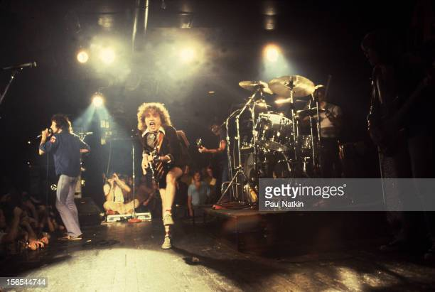 Australian rock group AC/DC performs at the Aragon Ballroom Chicago Illinois September 22 1978 Pictured are Bon Scott Angus Young Phil Rudd and...