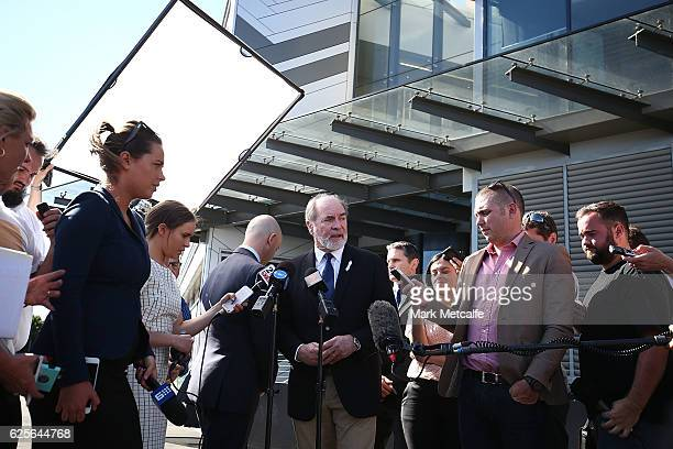 Australian Rugby League Commission Chairman John Grant speaks to the media as NRL CEO Todd Greenberg departs during a NRL press conference at Rugby...
